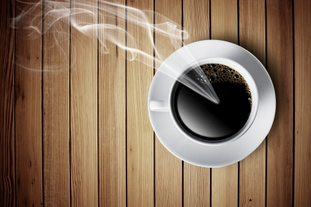 Hot cup of coffee with smoke on wood table photo