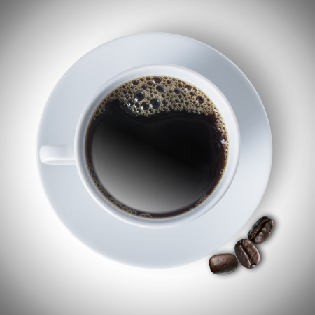 Hot cup of coffee with coffee beans photo