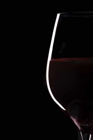 glass heart: Glass of wine on black