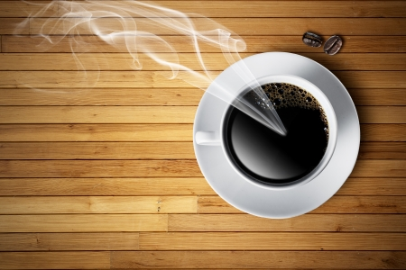 Cup of hot coffee with smoke and coffee beans photo