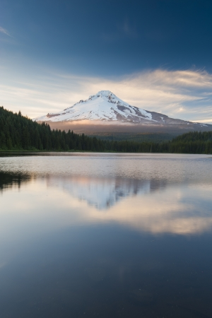 The volcano mountain Mt  Hood, in Oregon, USA  At sunset with reflection on the water of the Trillium lake  photo