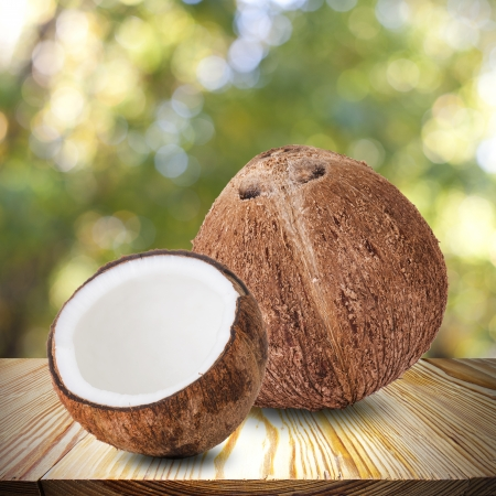 Coconut on wood table photo
