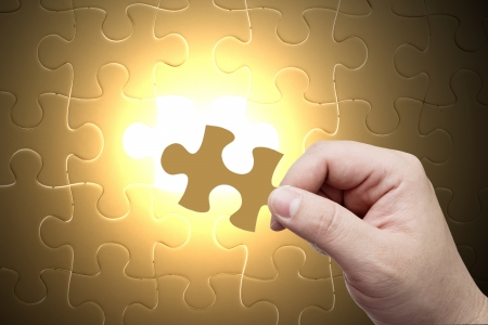 complete solution: Missing jigsaw puzzle piece with light glow, business concept Stock Photo