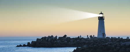 MARITIME: Lighthouse with light beam on ocean