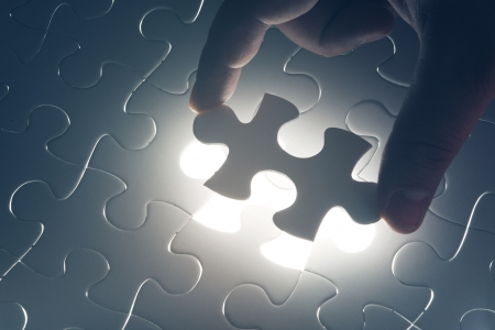 Missing jigsaw puzzle piece with light glow, business concept photo