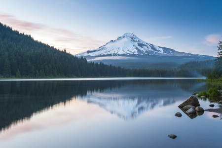 trillium lake: The volcano mountain Mt  Hood, in Oregon, USA  At sunset with reflection on the water of the Trillium lake
