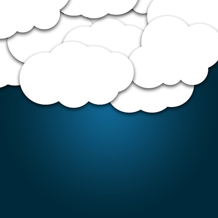 Paper cutout of cloud shape on blue background photo
