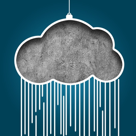 Paper cutout of cloud shape and rain on grunge background photo
