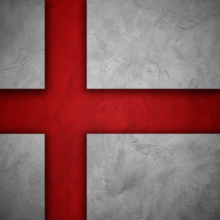 Flag of England  Holes cut on white grunge wall to show red wall behind to form flag of england photo