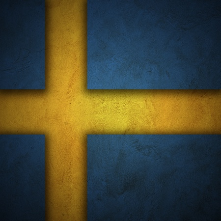 Flag of Sweden  Grunge wall and vintage style flag of Sweden photo