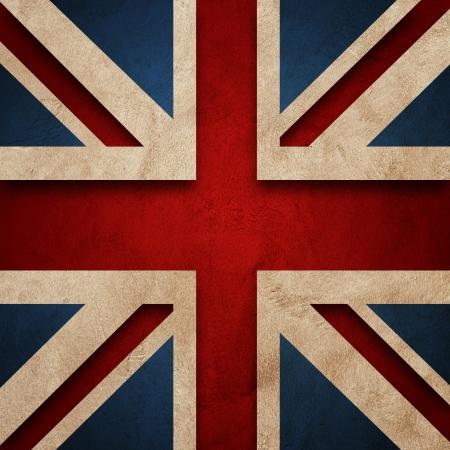 Flag of United Kingdom  Grunge wall and vintage style flag of United Kingdom photo
