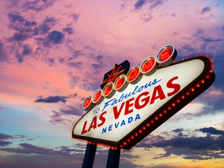 Welcome To Las Vegas neon sign at sunset photo