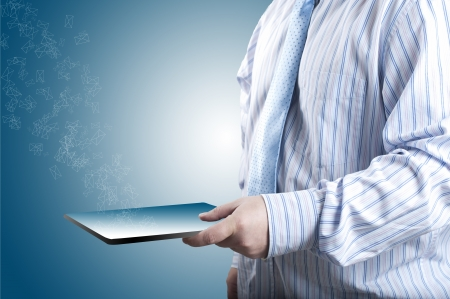 Business man holding tablet PC and sending emails photo