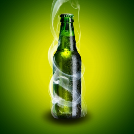 Smoke coming out from cold beer bottle on green background photo