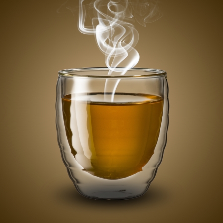 Glass of hot tea with smoke