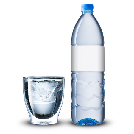 Glass and bottle of cold water photo