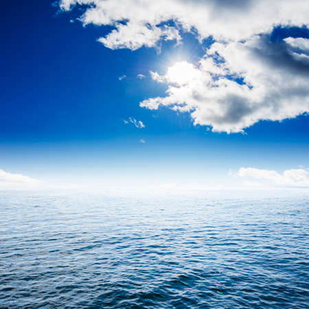 Ocean with cloudy blue sky photo
