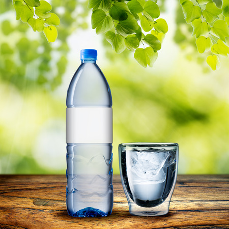 bottle label: Bottle and glass of water