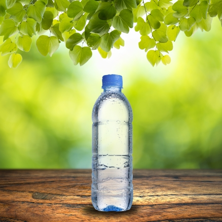 green water: Water Bottle on wood table Stock Photo