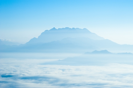 snow covered mountain: Mountain with fog