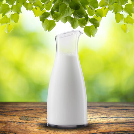 milk jug: jar of milk on wood table