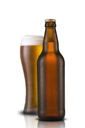 Beer glass with cold beer bottle photo