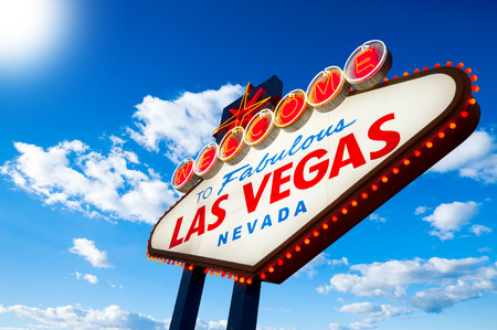 Welcome to Las Vegas neon sign on blue sky with sun photo