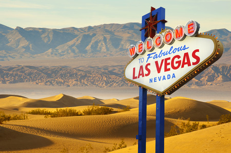 Welcome to Las Vegas neon sign with desert background photo