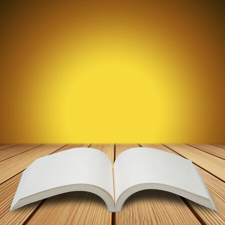 Open Book on Wood Table photo