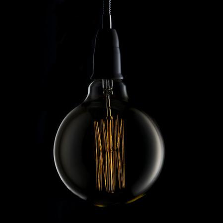 Light Bulb on Black Background photo