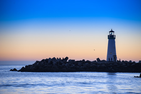 lighthouse with beam: Lighthouse at sunset