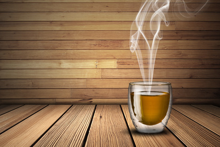 Hot Cup of Tea on Wood Table photo