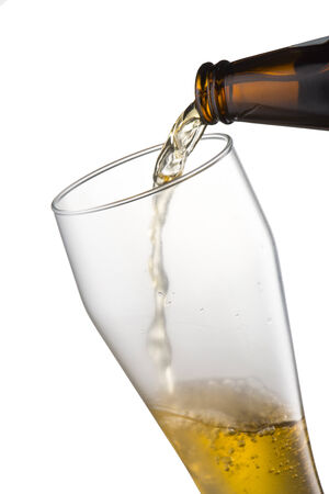 Beer pour into glass photo