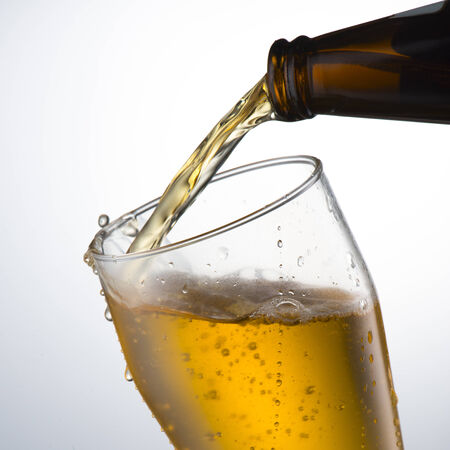 Beer pour into glass with grunge background photo