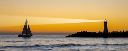 illuminative: Lighthouse at the Beach Stock Photo