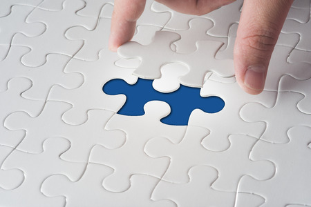 Missing jigsaw puzzle piece with light glow, business concept for completing the final puzzle piece Stock Photo - 32241455