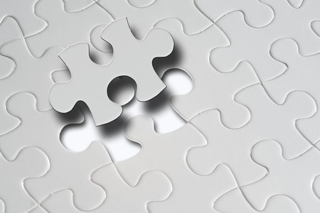 one piece: Missing jigsaw puzzle piece with light glow, business concept for completing the final puzzle piece