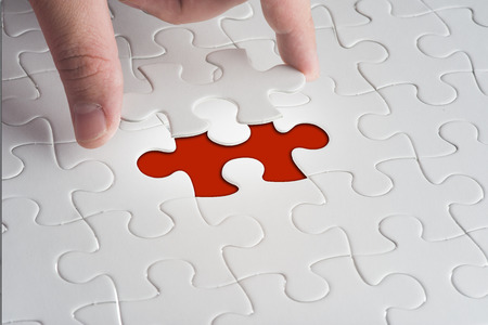 missing link: Missing jigsaw puzzle piece with light glow, business concept for completing the final puzzle piece