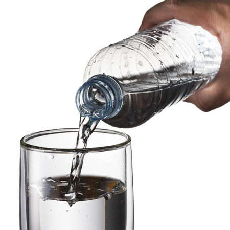 pour water: Water Pour from Water Bottle To Glass Stock Photo