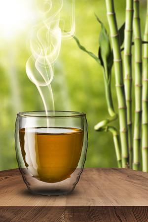 Glass of Tea on wood table photo