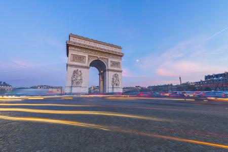 champs elysees quarter: Arc de Triomphe, Paris. France. At Sunset