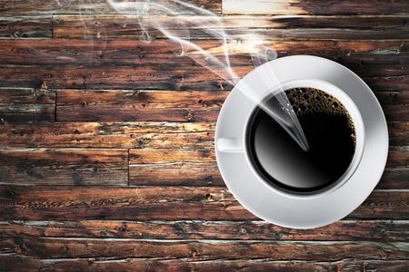 jamoke: Cup of hot coffee on wood table