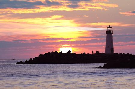 natural bridge state park: Silhouette Light house at sunset in Santa Cruz, California, USA Stock Photo