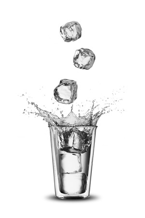 welling: Glass of Water With Ice Cubes Falling Stock Photo
