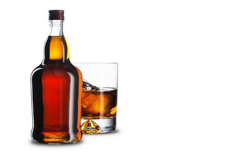 ガラスとウイスキーのボトル 写真素材