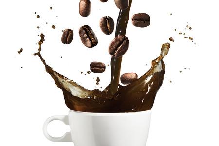 Koffie Splash en koffiebonen Stockfoto