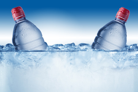 welling: Cold Water Bottle In Ice Bucket with Ice Cubes Stock Photo