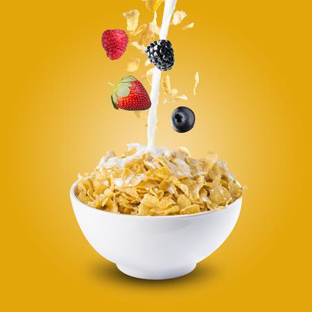 corn flakes: Corn Flakes With Various Berries Falling into Milk Splash