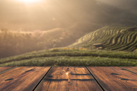 Wood Table With Beautiful Sunrise Scene in Background