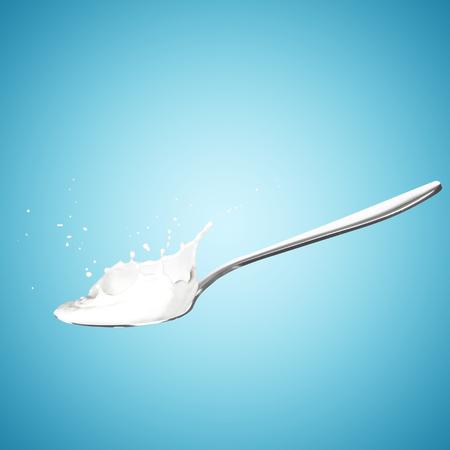 cuchara: Chapoteo de la leche en la cuchara